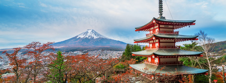 Mount Fuji and Chureito Pagoda at sunrise in autumn, Japan. The Pagoda is in Arakura Sengen Shrine where tourist can see Mt Fuji from panoramic view, one of the most famous view of Fuji Mountain. Stock Photo