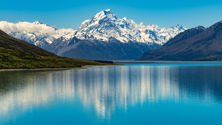 Mount Cook landscape reflection on Lake Pukaki, the highest mountain in New Zealand and popular travel destination. The mountain is in Aoraki Mount Cook National Park in South Island of New Zealand.