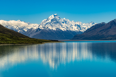 Mount Cook landscape reflection on Lake Pukaki, the highest mountain in New Zealand and popular travel destination. The mountain is in Aoraki Mount Cook National Park in South Island of New Zealand. Stock Photo