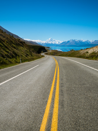 Road to Mount Cook, the highest mountain in New Zealand. A scenic highway drive along Lake Pukaki in Aoraki Mount Cook National Park, South Island of New Zealand. Shot at Highway 80 (Mt Cook Road).