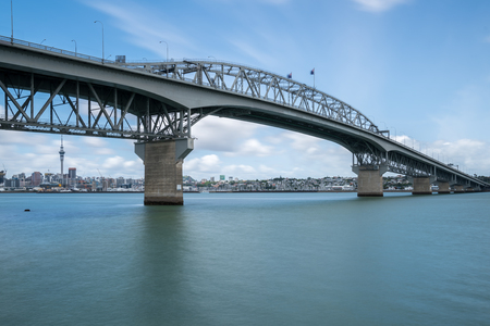 Auckland Harbour Bridge in Auckland, New Zealand, shot from Northcote using long exposure. The bridge joins St Marys Bay on the Auckland city side with Northcote on the North Shore side.