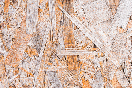 Recycled compressed wood chippings board background. Texture of wooden material. Stock Photo