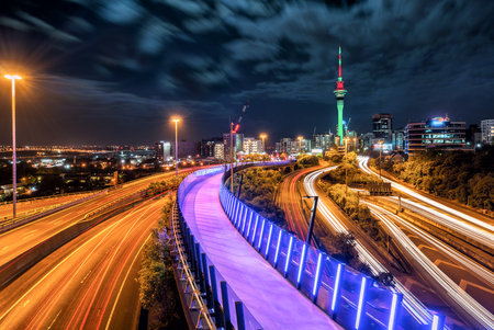 Auckland city night skyline with city center and Auckland Sky Tower, the iconic landmark of Auckland, New Zealand. Stock Photo