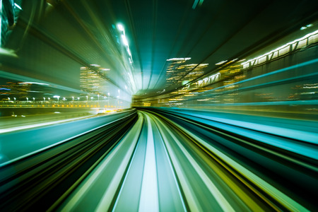 curve road: Motion blur train moving in city rail tunnel. Motion blur background abstract.