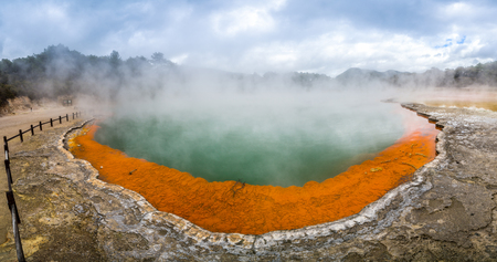 Champagne pool in Wai-O-Tapu thermal wonderland in Rotorua, New Zealand. Rotorua is known for geothermal activity, geysers and hot mud pool located around the Lakes of Rotorua.