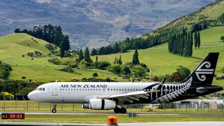 Queenstown, NEW ZEALAND - DEC 9, 2016: Airplane of Air New Zealand takes off from runway in Queenstown airport, Queenstown, South Island of New Zealand. Editorial