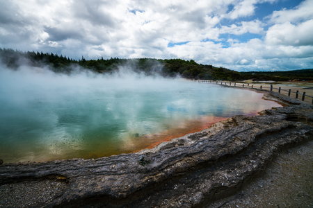 Sunrise at Champagne Pool in Wai-O-Tapu thermal wonderland in Rotorua, New Zealand. Rotorua is known for geothermal activity, geysers and hot mud pool located around the Lakes of Rotorua.