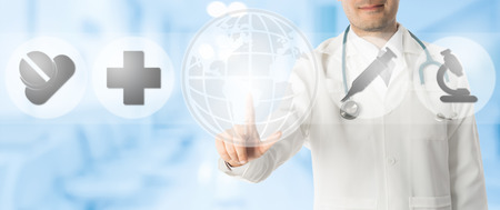 Medical Concept - Doctor points at copy space with icons showing symbol of research innovation for healthcare technology on blue abstract background. Stock Photo
