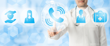 Medical Phone Consultation Concept - Doctor points at phone call icon showing communication with patient healthcare consultancy on blue abstract background.