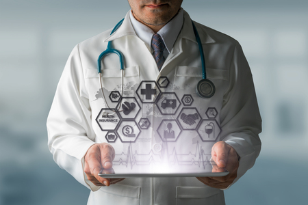 Health Insurance Concept - Doctor in hospital with health insurance related icons in modern graphic interface showing symbol of healthcare person, money saving, medical treatment and benefits.