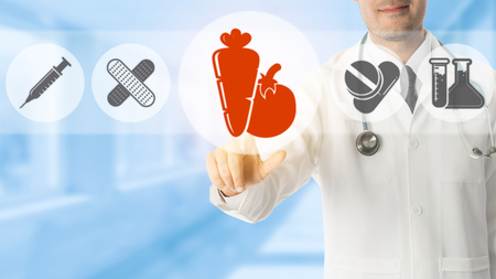 Healthcare nutrition concept. -  Doctor points at vegetable and fruit emphasizing healthy food for medical nutrition, healthy eating for illness treatment.