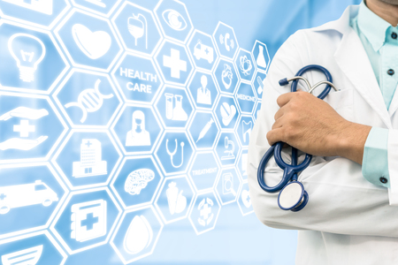Healthcare concept - Doctor on medical icons background showing symbols for healthcare person, medical treatment, emergency service, health technology research and medical insurance. Stock Photo