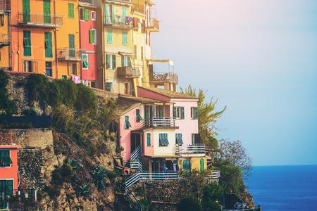 Colorful houses in Manarola Village, Cinque Terre Coast of Italy. Manarola is a beautiful small town in the province of La Spezia, Liguria, north of Italy and one of the five Cinque terre attractions.