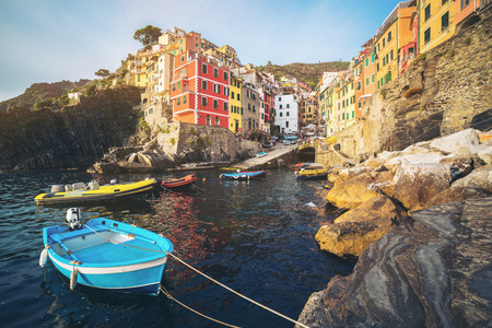 Riomaggiore of Cinque Terre, Italy - Traditional fishing village in La Spezia, situate in coastline of Liguria of Italy. Riomaggiore is one of the five Cinque Terre travel attractions.
