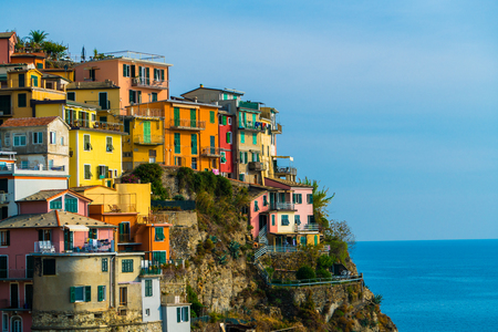 Colorful houses in Manarola Village, Cinque Terre Coast of Italy. Manarola is a beautiful small town in the province of La Spezia, Liguria, north of Italy and one of the five Cinque terre attractions.