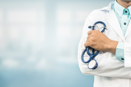 Doctor in hospital background with copy space. Healthcare and medical concept.