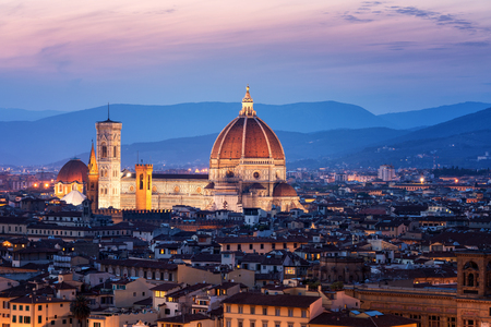 Florence Cathedral (Cattedrale di Santa Maria del Fiore) in historic center of Florence, Italy with night panoramic view of the city. Florence Cathedral is major tourist attraction of Tuscany, Italy. Stock fotó