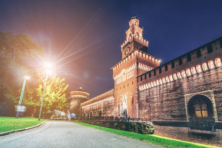 Sforza Castle (Castello Sforzesco) at night in Milan, Italy. The castle was built in the 15th century by Sforza, Duke of Milan. It is the main travel destination for tourist visiting Milan, Italy.