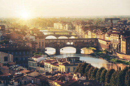 Florence Ponte Vecchio Bridge and City Skyline in Italy. Florence is capital city of the Tuscany region of central Italy. Florence was center of Italy medieval trade and wealthiest cities of past era.