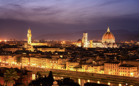 Florence Cathedral (Cattedrale di Santa Maria del Fiore) in historic center of Florence, Italy with night panoramic view of the city. Florence Cathedral is major tourist attraction of Tuscany, Italy. Archivio Fotografico