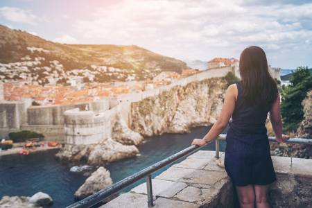 Woman traveller at Dubrovnik Old Town, in Dalmatia, Croatia - The prominent travel destination of Croatia