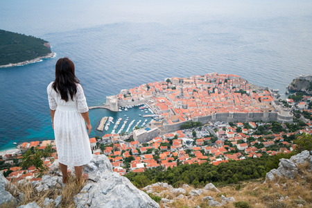 Traveller looking at view of Dubrovnik Old Town, in Dalmatia, Croatia, the prominent travel destination of Croatia. Dubrovnik old town Reklamní fotografie