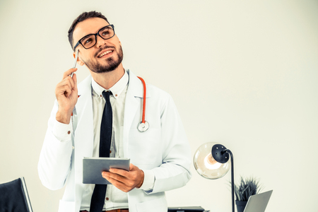 Doctor working on tablet computer at office in the hospital. Medical and healthcare concept. Stock fotó