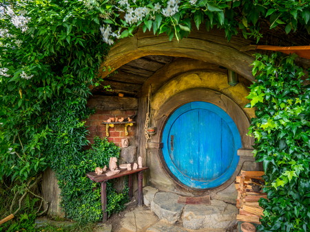 Matamata, New Zealand - Dec 11, 2016: Hobbiton movie set created for filming The Lord of the Rings and The Hobbit movies in North Island of New Zealand. It is opened for tourist who visit New Zealand. Stok Fotoğraf - 107813534