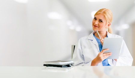 Doctor using tablet computer at the hospital. Medical healthcare and doctor staff service. Фото со стока