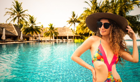 Happy young woman wearing swimsuit at tropical sand beach resort in summer for holiday travel vacation. Zdjęcie Seryjne