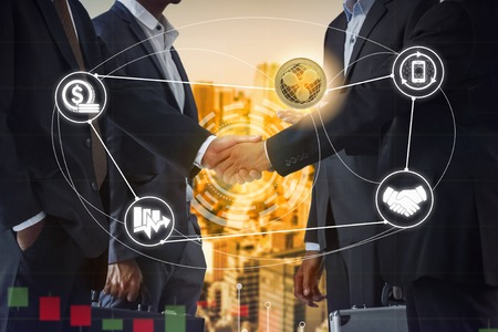 Ripple XRP and cryptocurrency payment acceptance concept - Businessman handshaking showing accepted payment by using Ripple coin. Blockchain and financial technology.
