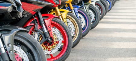 Motorcycles group parking on city street during adventure journey. Motorcyclists community travel concept. Stock fotó