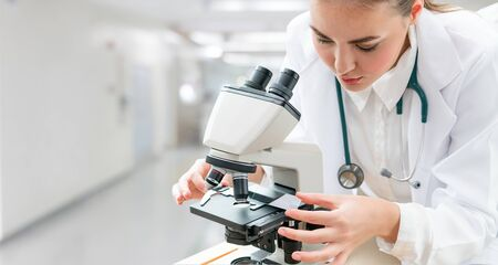 Scientist researcher using microscope in laboratory. Medical healthcare technology and pharmaceutical research and development concept. Stock fotó