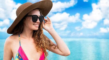 Happy young woman wearing swimsuit at tropical sand beach resort in summer for holiday travel vacation. Standard-Bild - 133527241