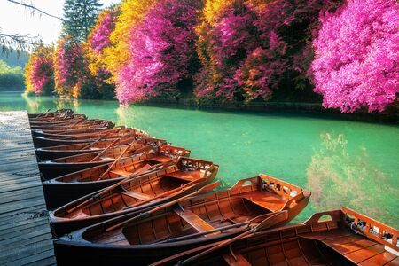 Boats parking at pier with turquoise lake landscape of Plitvice Lakes National Park, famous travel destination of Croatia. The lakes are located in central Croatia (Croatia proper). Reklamní fotografie
