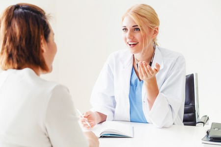 Female patient visits woman doctor or gynecologist during gynecology check up in office at the hospital. 版權商用圖片