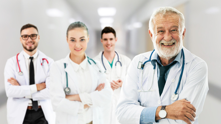 Healthcare people group. Professional doctor working in hospital office or clinic with other doctors, nurse and surgeon.