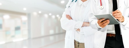 Healthcare people group. Professional doctor working in hospital office or clinic with other doctors.