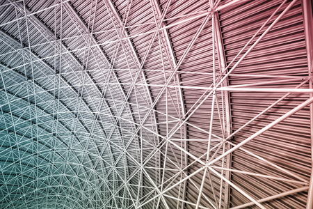 Modern interior architecture of metal steel roof structure of airport or industrial factory.