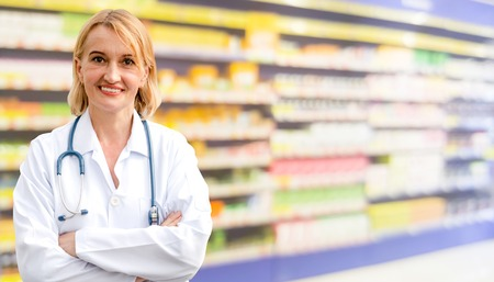 Senior woman pharmacist working in the pharmacy. Medical healthcare and medicine service. Stok Fotoğraf