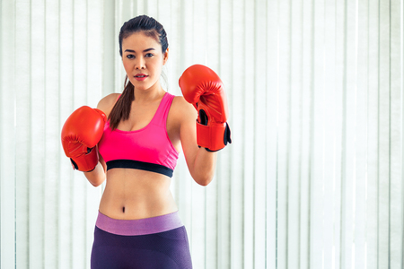 Boxer woman does boxing sport in fitness gym. Healthy lifestyle.