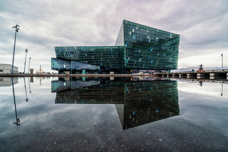 Reykjavik, Iceland - July 3, 2018 : Beautiful Harpa building in Reykjavik, Iceland. Harpa is a complex with concert hall, theater and conference center located in center of Reykjavik, Iceland. Editorial