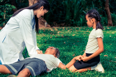 Senior man having chest pain or heart attack in the park. Old people elderly healthcare concept.