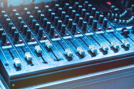 Amplifier mixer and equalizer in studio room in close up view. Stock Photo