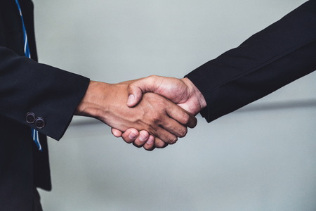 Business people agreement concept. Businessman do handshake with another businessman in the office meeting room. Stock fotó