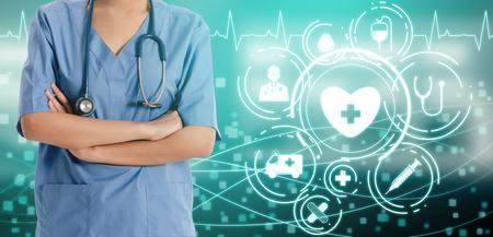 Medical Healthcare Concept - Doctor in hospital with digital medical icons graphic banner showing symbol of medicine, medical care people, emergency service network, doctor data of patient health. Reklamní fotografie