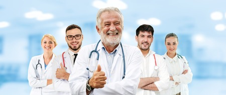 Healthcare people group. Professional doctor working in hospital office or clinic with other doctors, nurse and surgeon. Medical technology research institute and doctor staff service concept. 版權商用圖片