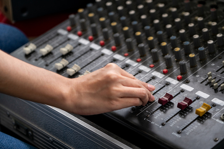 Amplifier mixer and equalizer in studio room in close up view. Archivio Fotografico
