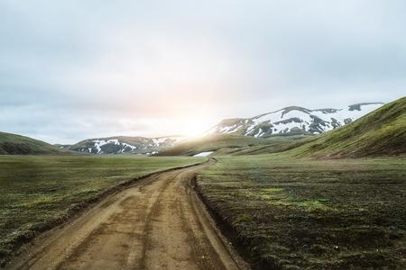 Beautiful Landmanalaugar gravel dust road way on highland of Iceland, Europe. Muddy tough terrain for extreme 4WD 4x4 vehicle. Landmanalaugar landscape is famous for nature trekking and hiking. Stock Photo