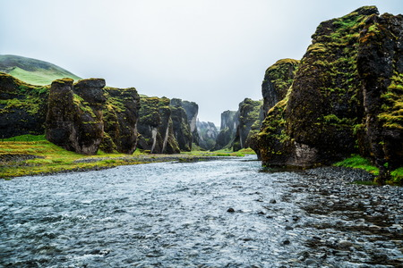 Unique landscape of Fjadrargljufur in Iceland. Top tourism destination. Fjadrargljufur Canyon is a massive canyon about 100 meters deep and about 2 kilometers long, located in South East of Iceland. Stock Photo